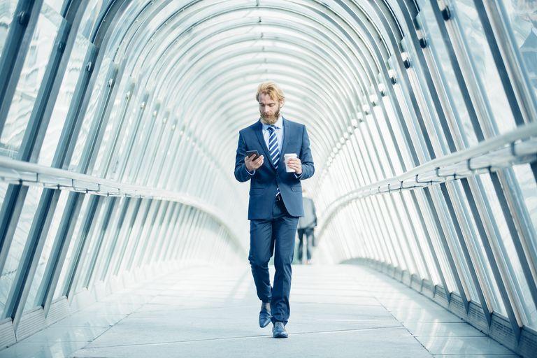 Businessman walking in financial district