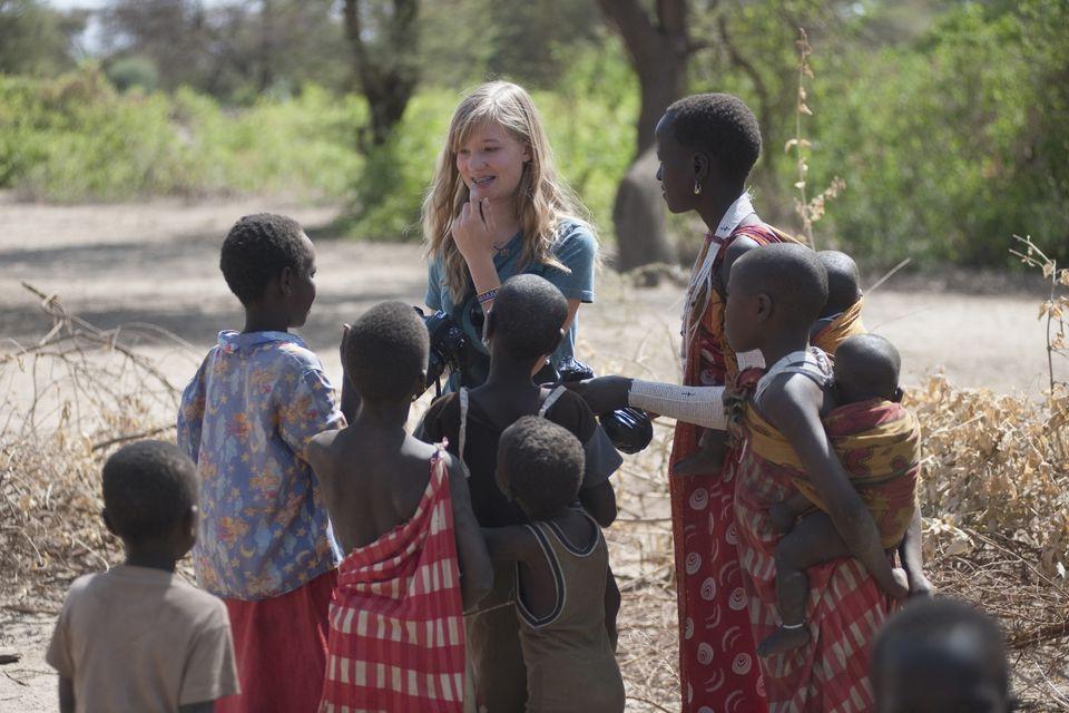 Caucasian Woman Among Maasai Kids