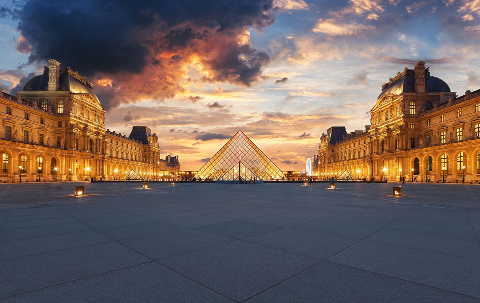 The louvre museum in Paris is one of the biggest museums in the world and houses works of art such as the Mona Lisa.