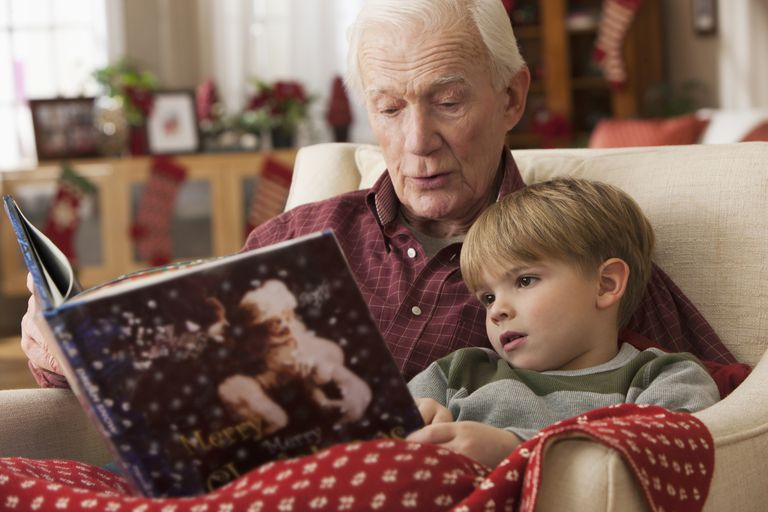 grandparent and grandchild share christmas book