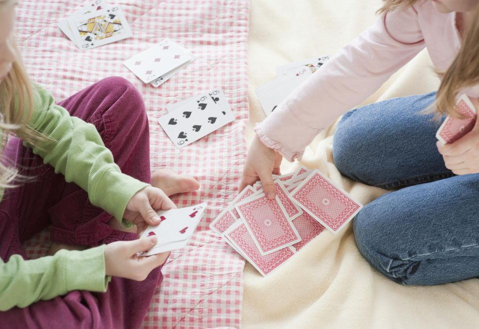 Two young girls playing card game, close up
