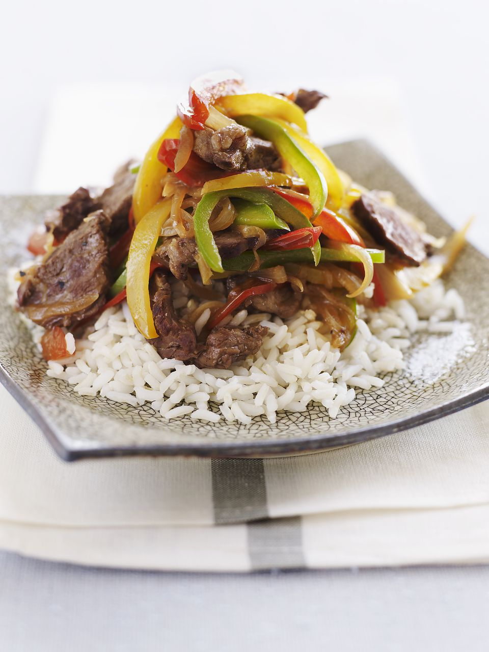 Steak and Peppers over Rice