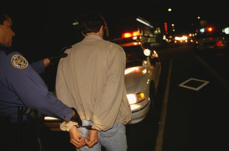 Teenage boy (16-17) being arrested