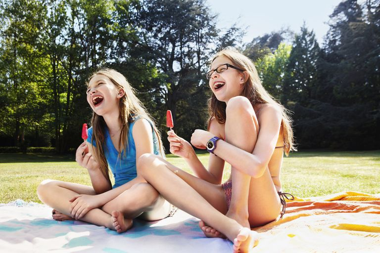 Girls laughing with ice lolly