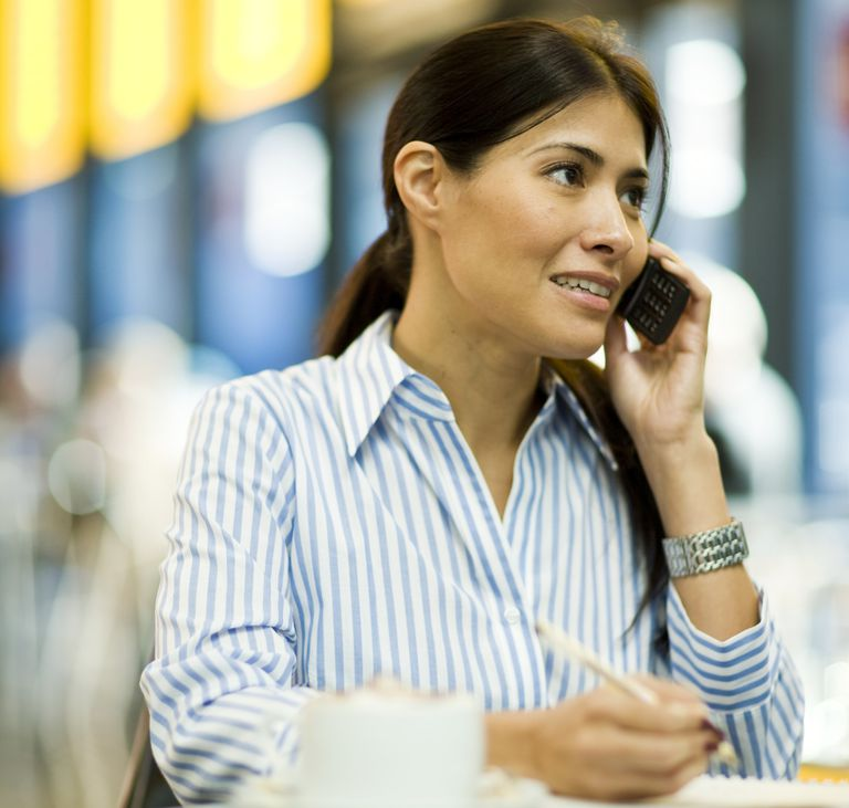 A photo of an apprehensive woman talking on her cell phone