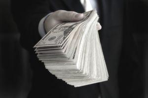Man holding large amount of cash