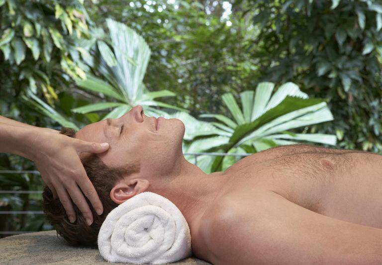 Man having head massage at health spa