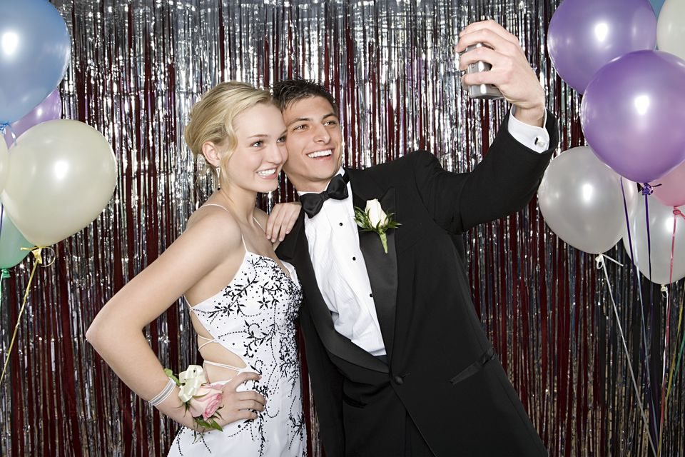 Teenage boy and girl taking a picture at prom