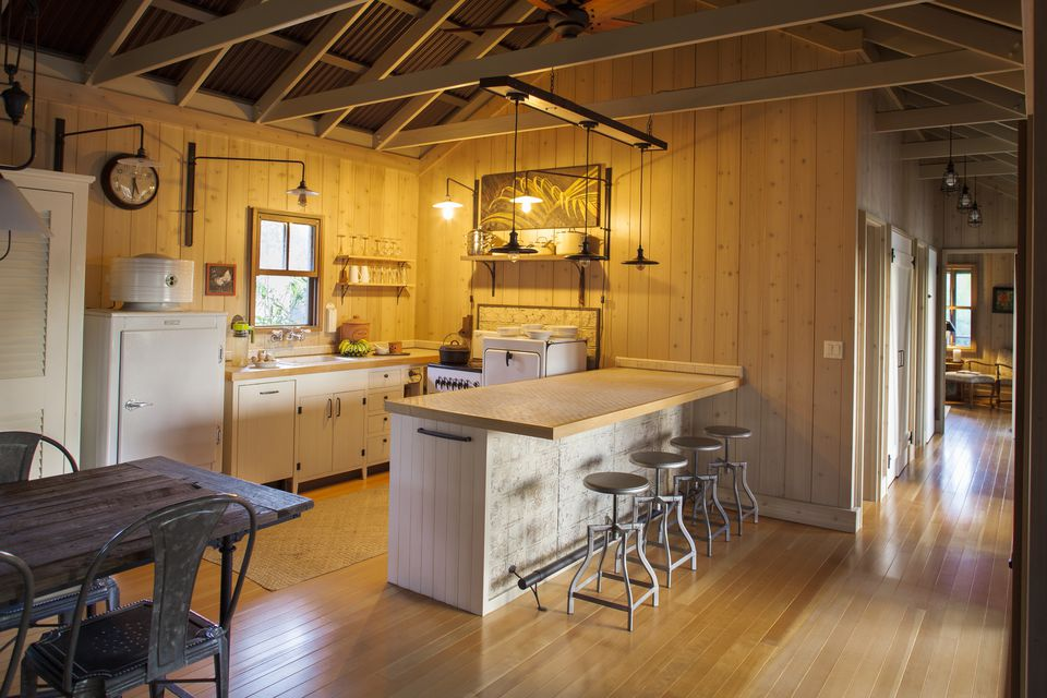 A country kitchen with an open beam ceiling