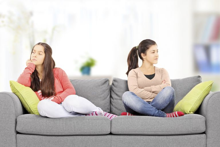 two angry girls on a couch
