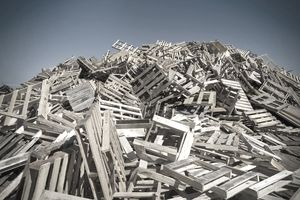 Mountain of wood pallets to be crushed in to mulch
