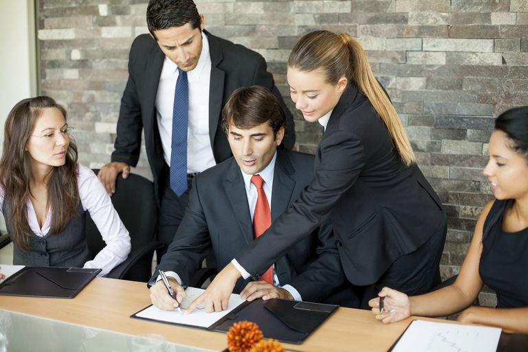Employees explain personalized benefits including variable compensation to a new employee.