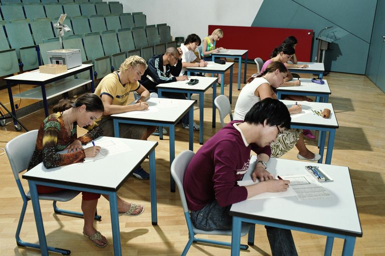 Students writing in examination hall, elevated view