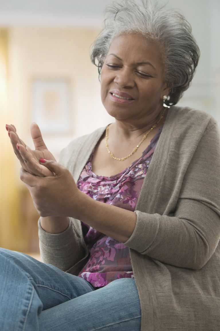 Older African American woman rubbing her hand