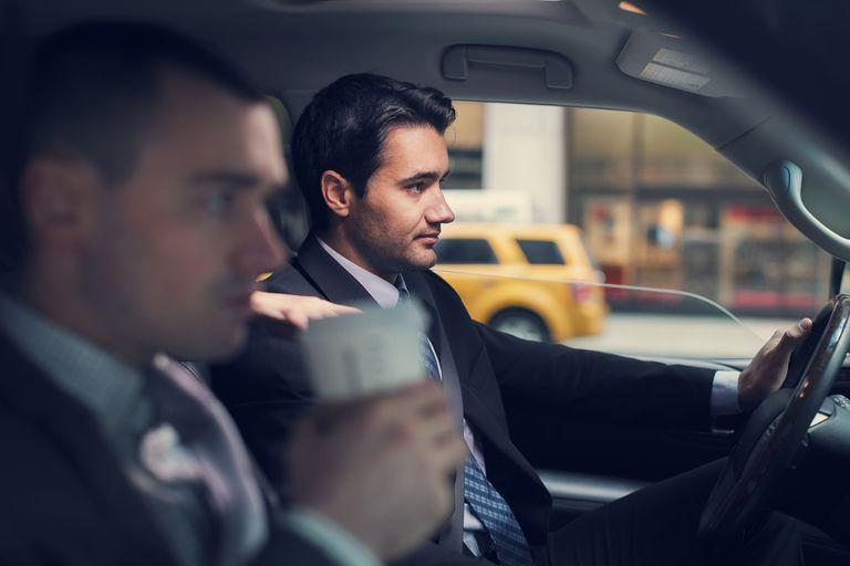 Two businessmen in car