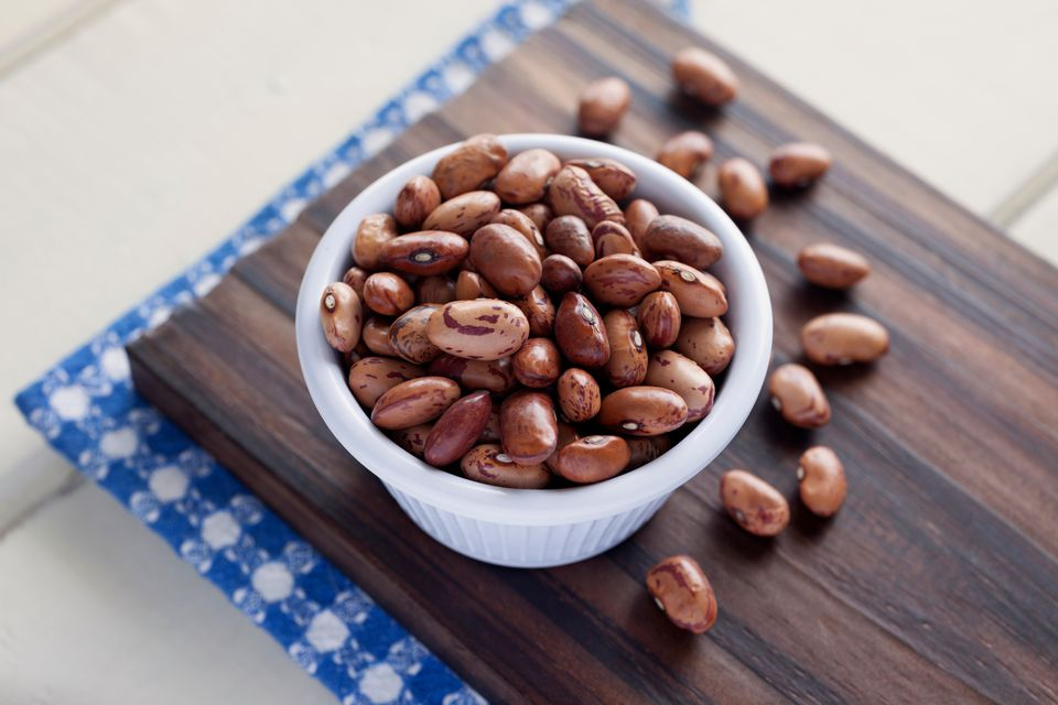Close-Up Of Pinto Beans In Bowl On Cutting Board