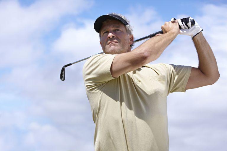Man swinging golf club