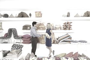 Salesman in Home Furnishings Store Shaking Customer's Hand