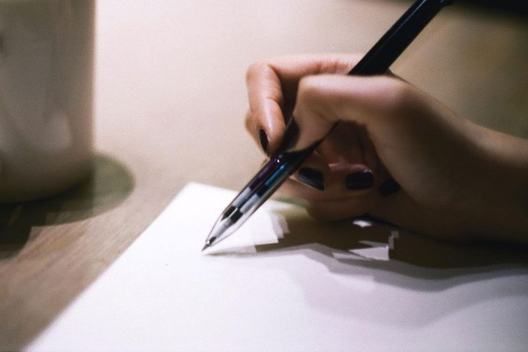 person writing on paper