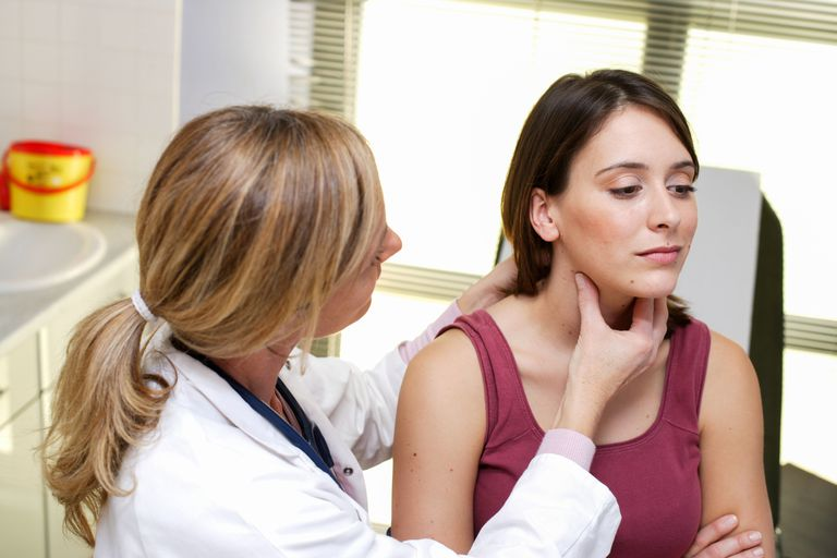 Medical consultation Doctor examining the thyroid gland of a patient.