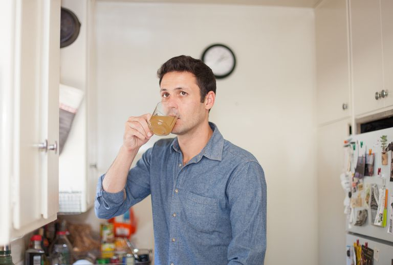 Man drinking tea at home