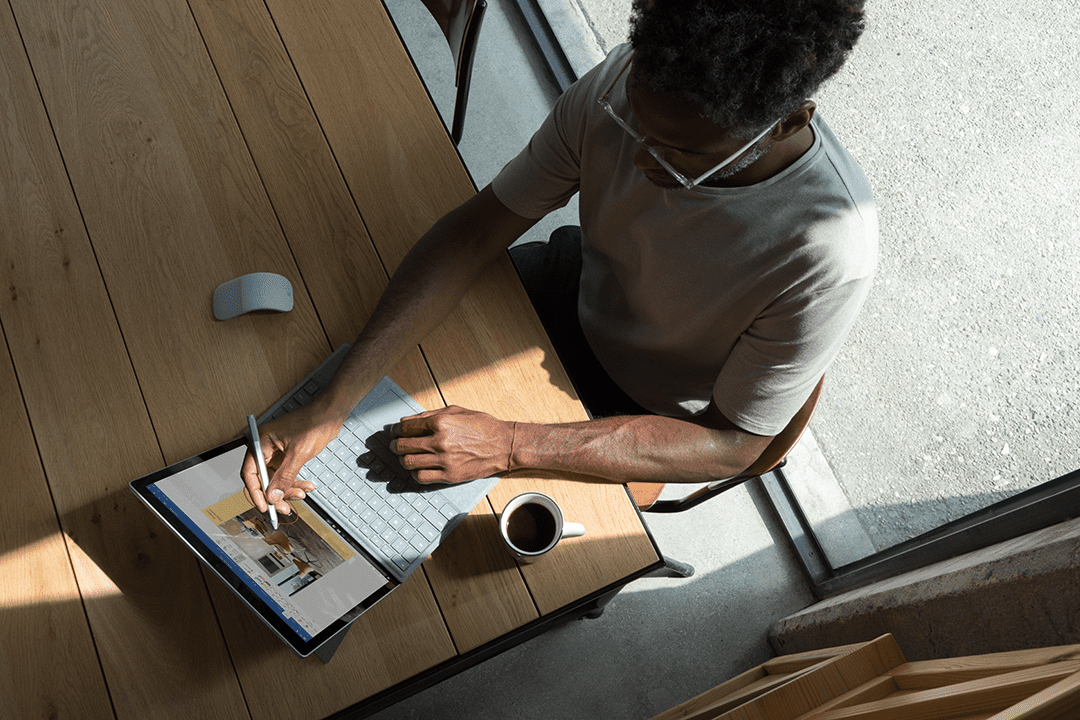 Man using Microsoft Surface Pro with Pen