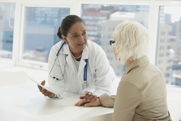 Indian doctor talking with patient