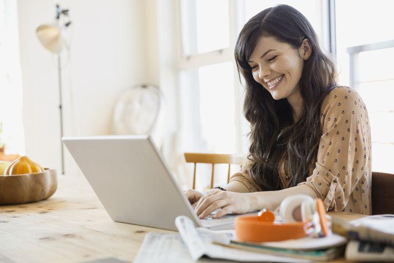 Woman reading at laptop