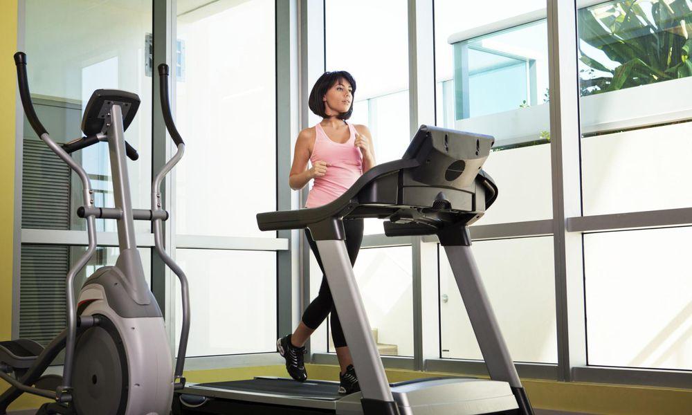 Woman running on treadmill in gym