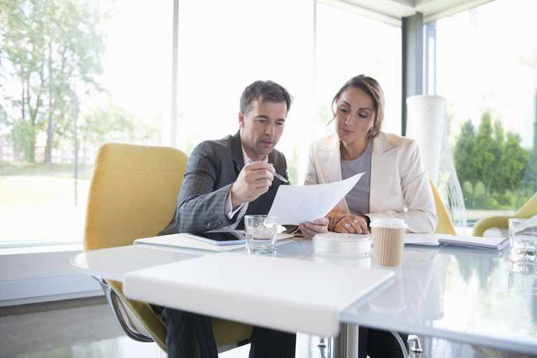 Business people doing paperwork in conference room