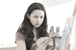 Woman painting at easel
