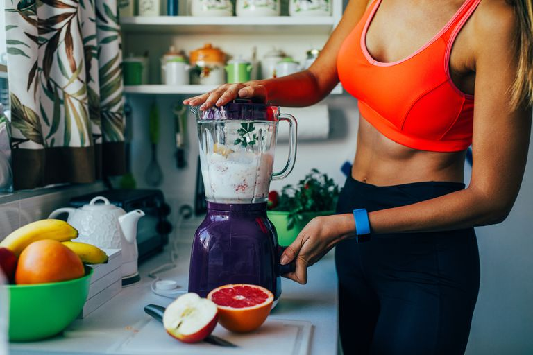Making a healthy smoothie on a blender