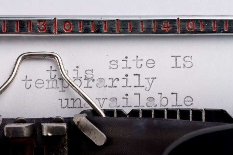 Picture of a vintage typewriter with error message indicating that a website is temporarily unavaialble