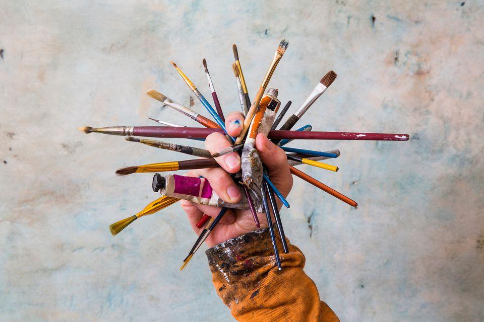 Hand holding art supplies