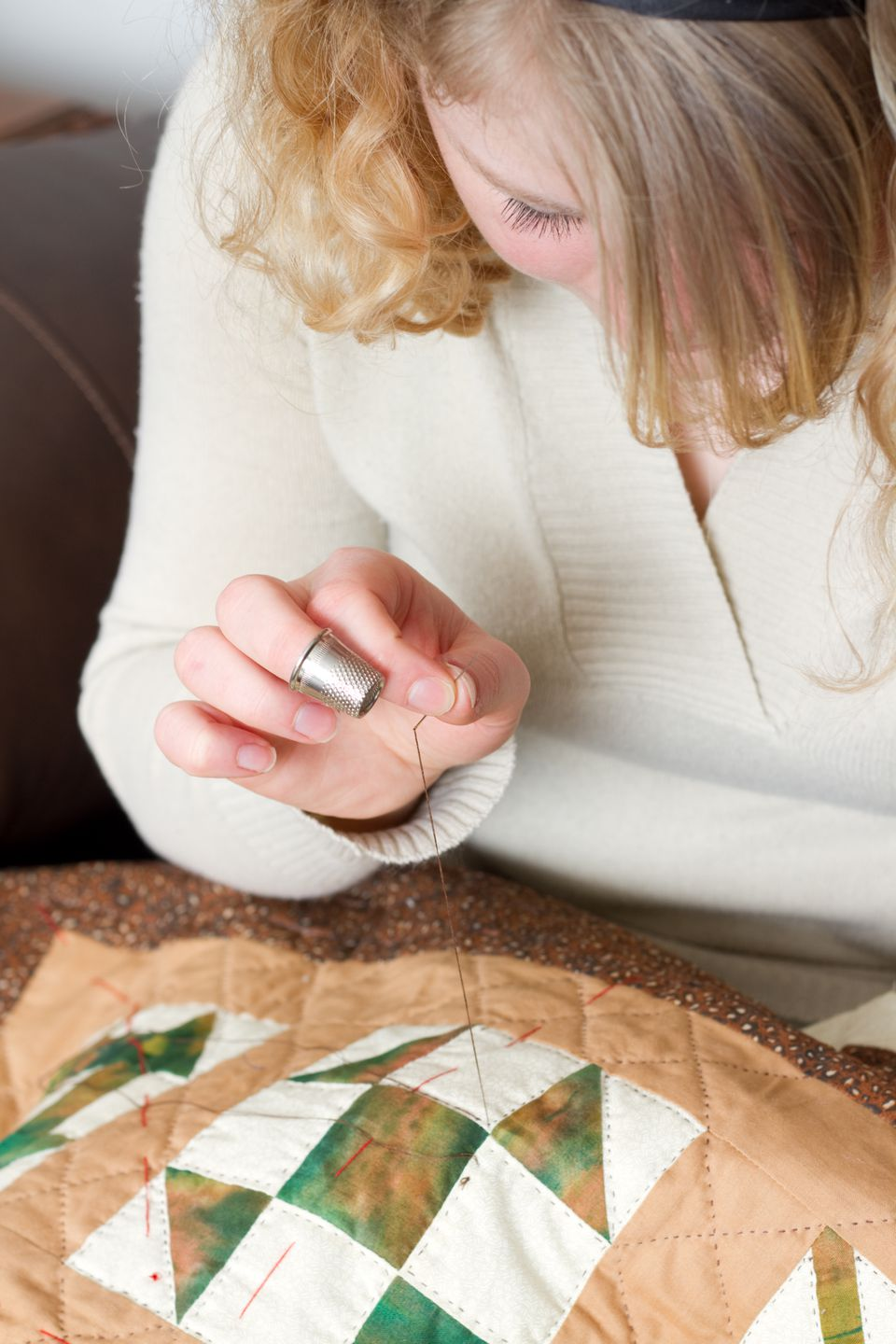 Young Woman Quilting
