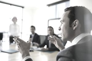Close up businessman gesturing in conference room meeting