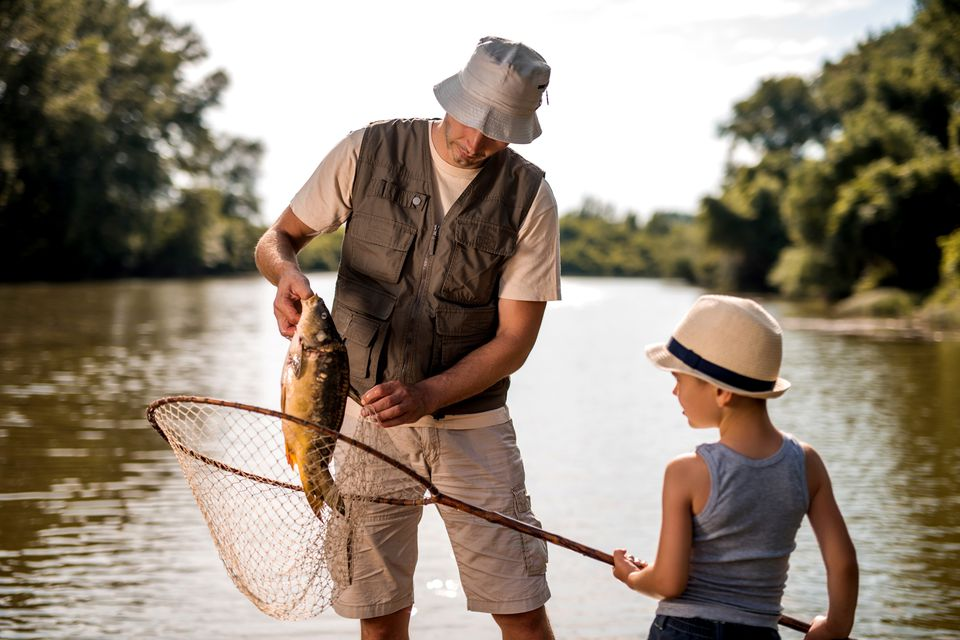 Teamwork of a water and son on fishing.