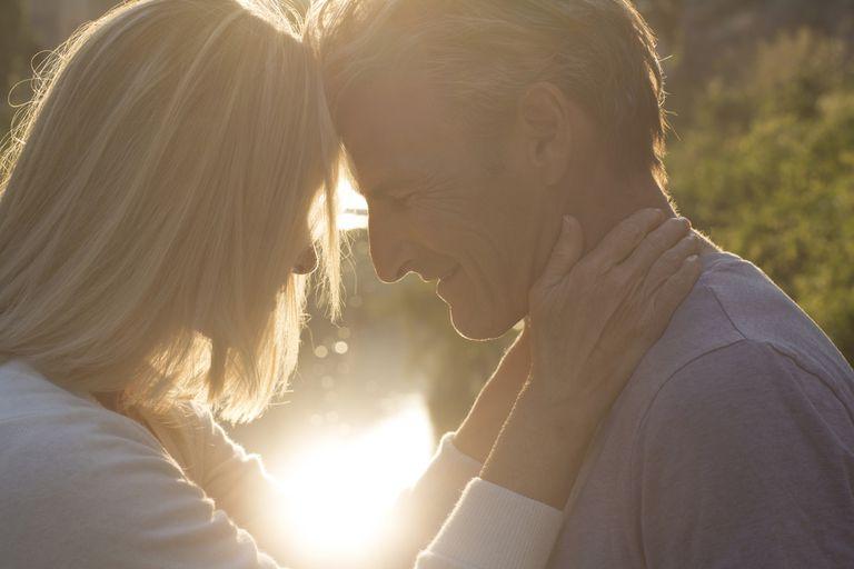 Couple embrace at sunrise