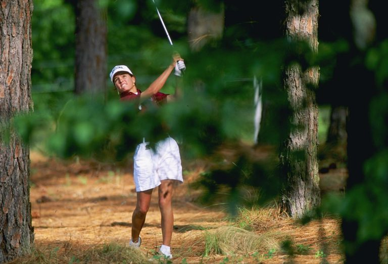 Golfer Marisa Baena swings away from the pine needles