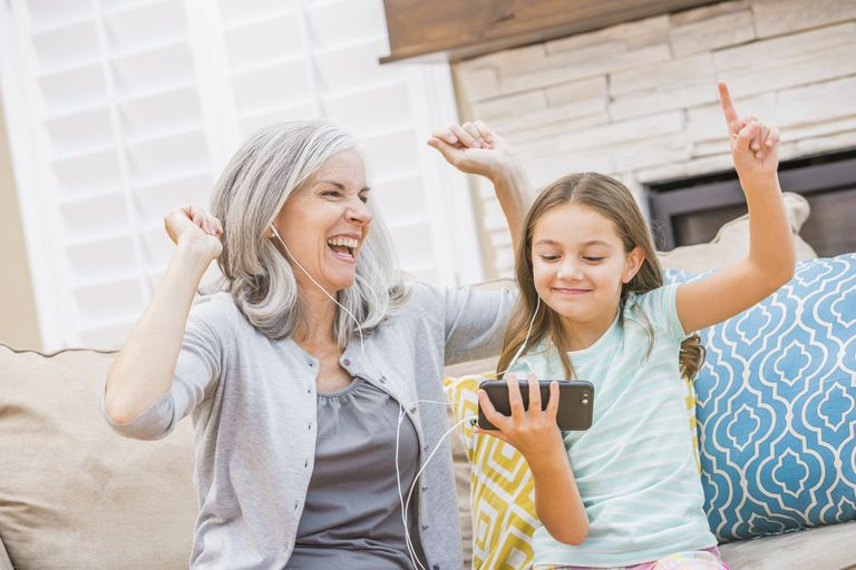 Hip grandmother and granddaughter listening to music