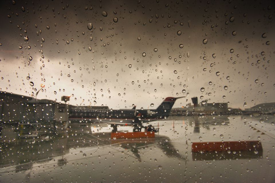 View of rainy tarmac from window