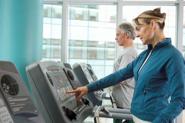 Runner touching treadmill controls