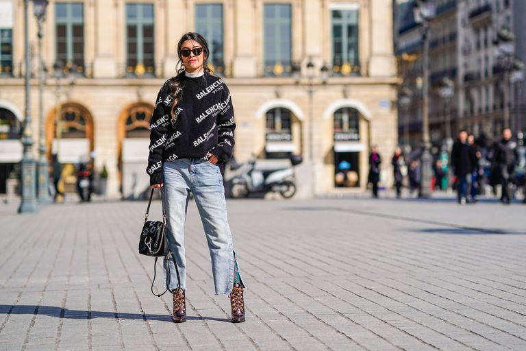 Paris street style woman in wide leg jeans