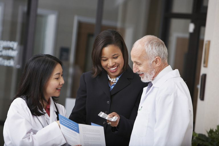 woman talking to doctors about medical brochure