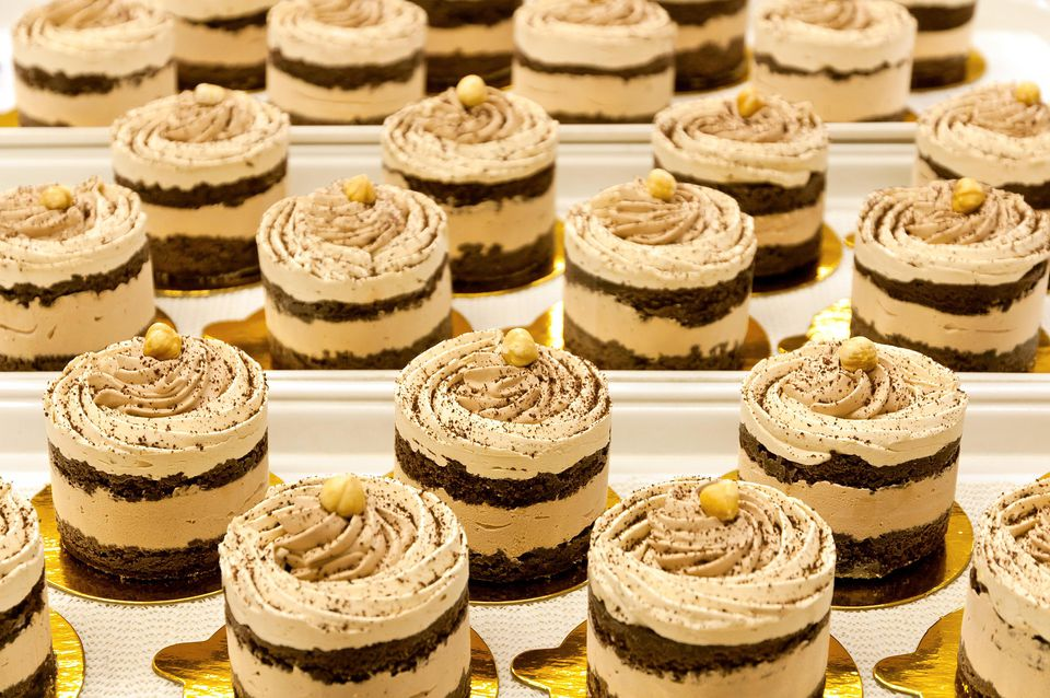 Gourmet multilayer chocolate cakes decorated with hazel nuts