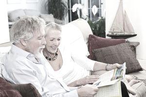 Senior couple looking at new homes.