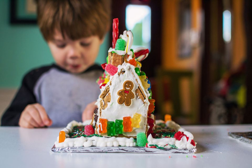 child building gingerbread house