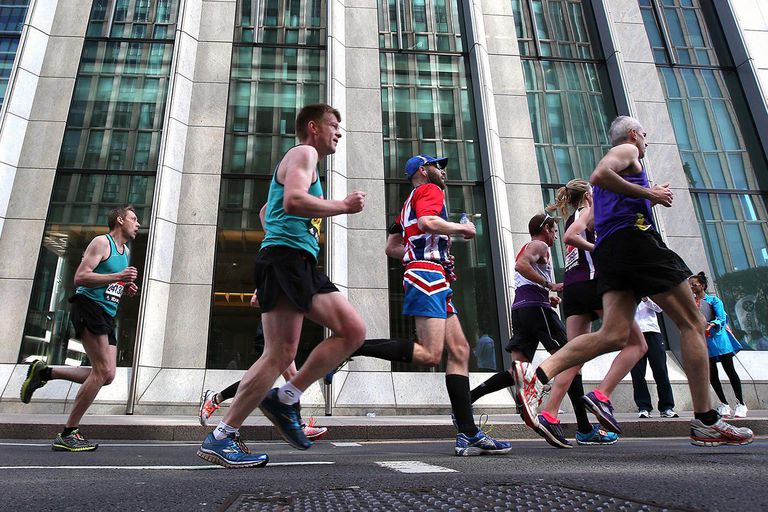 Fun Runners make their way through Canary Wharf during the Virgin Money London Marathon 2014 on April 13, 2014 in London, England.