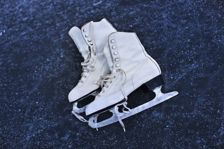 Close up of ice skates on ice