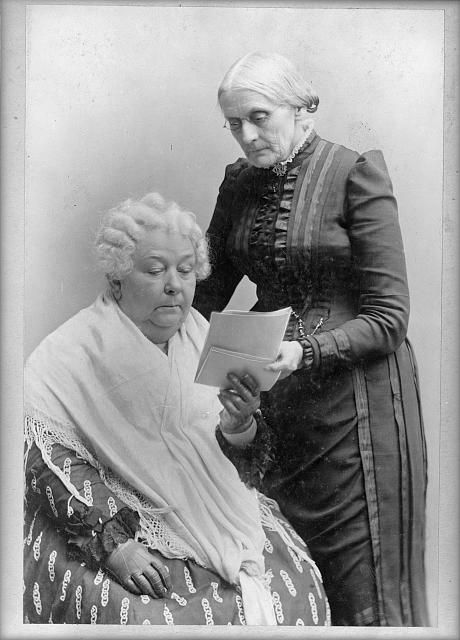 Elizabeth Cady Stanton, seated, and Susan B. Anthony, standing
